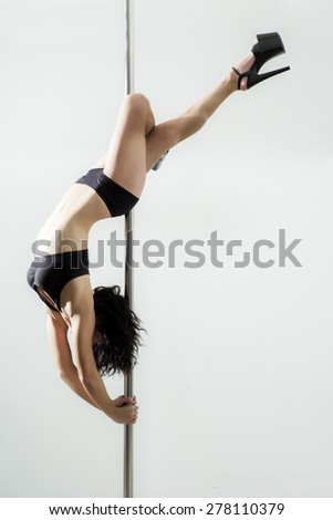 Flexible Sexy Woman Dancing In Black Lingerie On The Pole On White Background Copyspace Vertical