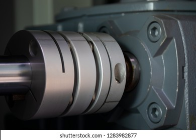 A flexible shaft coupling installed on reduction gearbox and stepping motor shaft for torque reduction of the different load between the drive shaft and the driven shaft.