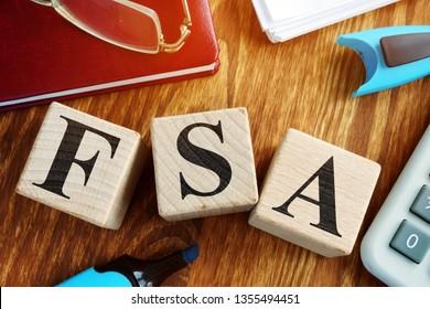 Flexible Spending Account FSA from wooden cubes. - Shutterstock ID 1355494451