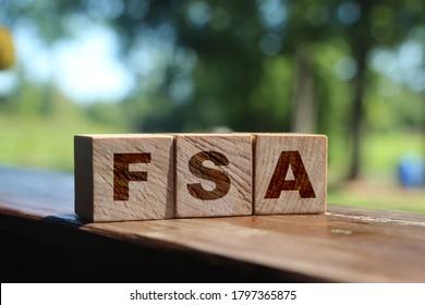 Flexible spending account FSA written on a wooden cubes. - Shutterstock ID 1797365875