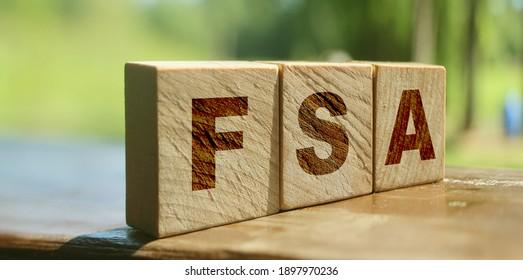 Flexible spending account FSA written on a wooden cubes. Financial concept. - Shutterstock ID 1897970236