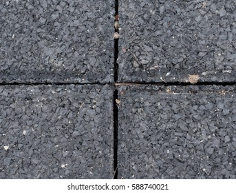 Flexible tile for playground. Tiles made from a mixture of rubber crumb and a flexible core. Flexible floor for outdoor exercise
