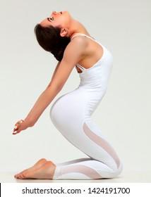 Flexy sports woman posing on white background