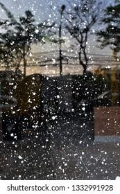 Flick the white color into the window glass, Colour splash in monotone, Wallpaper flick paint brush