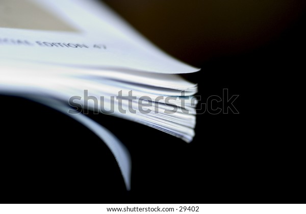 Flicked edges of a magazine/book with very narrow depth of focus.