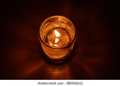 The flickering candle.