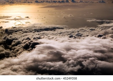 flight above the clouds, at evening