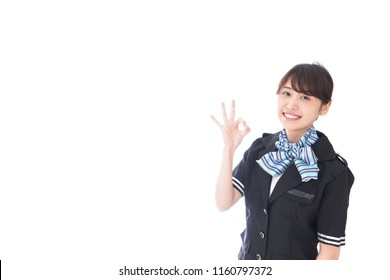 flight attendant giving ok sign
