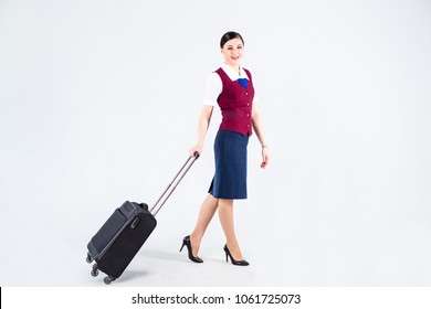 Flight attendant in a red vest with Luggage