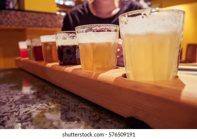Flight of Beers for Tasting in a Pub.