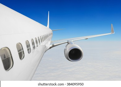 In flight commercial airplane flying above the cloud