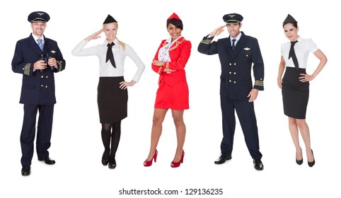Flight crew members, pilots, stewardesses. Isolated on white