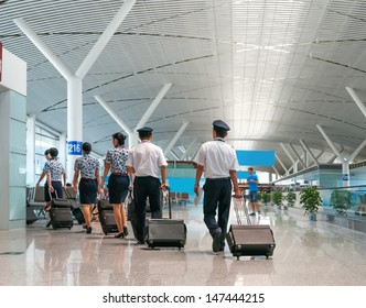 A Flight Crew Walking in the Airport