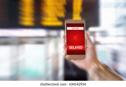 Flight delayed. Delay in flying schedule. Aeroplane will take off late. Smartphone application announces bad news to tourist. Woman holding mobile phone in airport terminal. Timetable background.