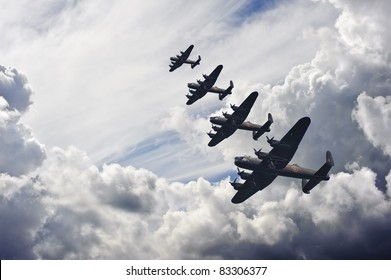 Flight formation of Battle of Britain World War Two consisting of Lancaster bombers banking right