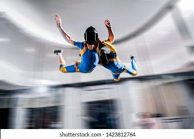 Flight free fall simulation.  Peoples flight in wind tunnel. Indoor skydiving simulation.  Swim in wind tunnel. New  sport in flight technology simulation.