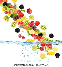 Flight of fruits and berries in water