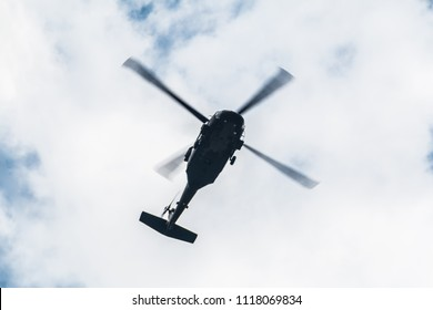 Flight of the helicopter,on sky background.