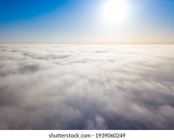 Flight high above the clouds. Aerial drone view.