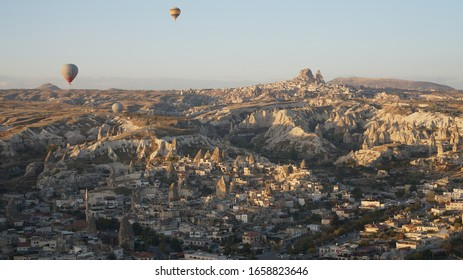 Flight in a hot air balloon over Goreme town with a spectacular aerial panoramic view to the Cappadocia landscape in Central Anatolia, Turkey.