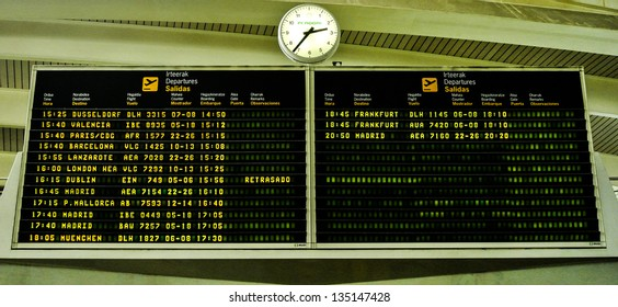 Flight information board in airport terminal