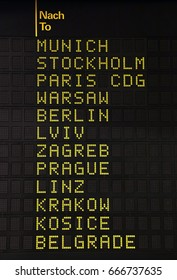 Flight information panel desk at airport, with different city destinations, close up, low angle view