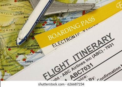 Flight Itinerary with boarding pass , map and airplane toy - concept for travel.
