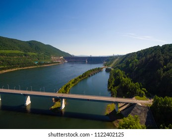 Flight over the Yenisei River, a view of the bridge and a dam of hydroelectric power station, shooting from air