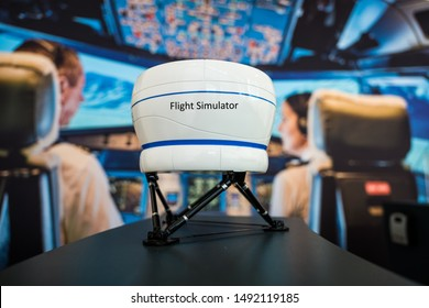 Flight Simulator model in front of a big cockpit picture in a flight simulator training center