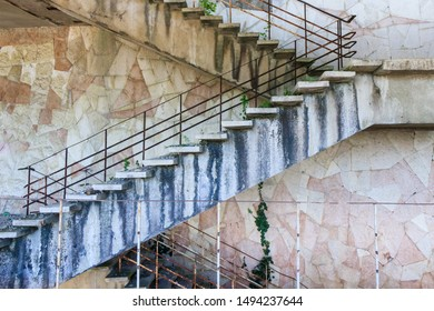 a flight of stairs in an abandoned building