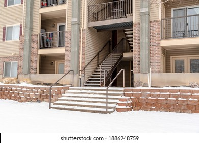 Flight of stairs and balconies viewed at the facade of a residential building
