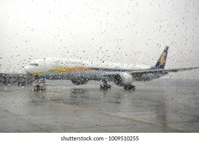 Flight stranded during rain and bad weather in Mumbai airport, India.