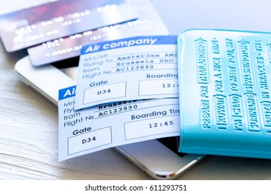 flight tickets payment online with cards on light wooden table