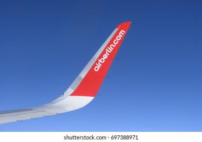 FLIGHT FROM ZURICH, SWITZERLAND TO PALMA DE MALLORCA, SPAIN - JUNE 20, 2017: A wing of the airplane from Air Berlin, which is the second largest airline in Germany