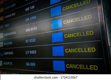 flights cancellation status on flights information board in airport because coronavirus or pandemic effected. flight cancellation, airline business crisis, airline bankrupt, tourism crisis concept