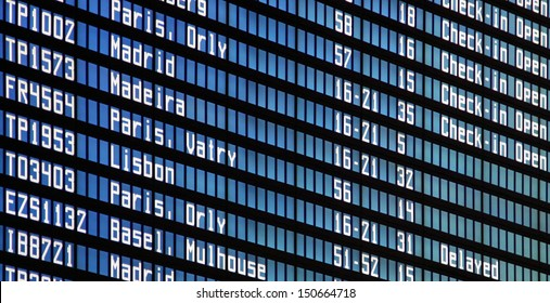 Flights information board at airport terminal
