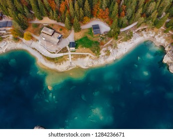 Flims caumasee blue water lake at Switzerland alpine mountains, sunny, summer landscape, blue sky top view