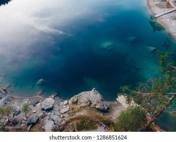 Flims caumasee blue water lake at Switzerland alpine mountains, sunny, summer landscape, blue sky