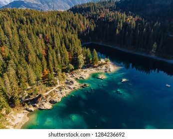 Flims caumasee lake at Switzerland drone aerial, alpine mountains, sunny, summer landscape, blue water