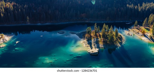 Flims caumasee lake at Switzerland drone aerial, alpine mountains, sunny, summer landscape, blue water panorama