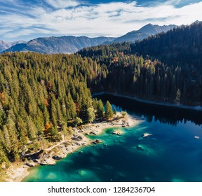 Flims caumasee lake at Switzerland drone aerial, alpine mountains, sunny, summer landscape, blue water square panorama