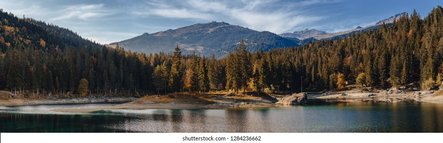 Flims lake at Switzerland alpine mountains, sunny, summer landscape, blue sky panorama