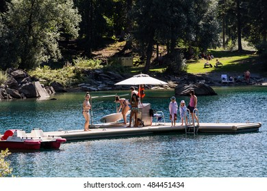 FLIMS, SWITZERLAND - SEPTEMBER 9, 2016: View of a paddleboat and paddleboard rental point at the Lake of Cauma near Flims on September 9, 2016. Flims is a popular hiking and winter sport area.