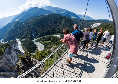 FLIMS, SWITZERLAND - SEPTEMBER 9, 2016: People on the platform Il Spir near Flims on September 9, 2016. The platform provides a beautiful overlook to the Rhine Valley in the canton Graubunden.