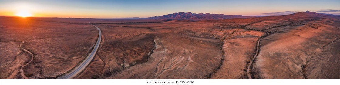 Flinders Ranges peaks at orange sunset - aerial panorama