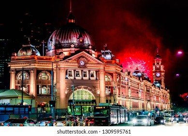 Flinders Street Station in Melbourne, Australia at night  with fireworks in the background