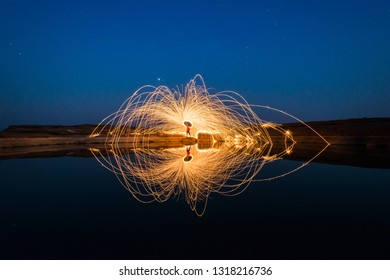 Fling fire picture. Light lines of steel wool with long exposure.
