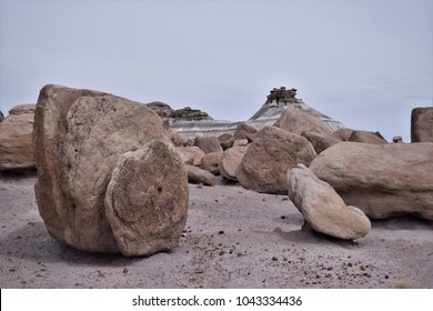 Flinstone like quarry.  Large boulders scattered about desert landscape.
