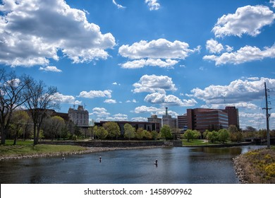 Flint, Michigan - May 14, 2019: Flint, Michigan skyline and the Flint River. Known widely for their water quality and safety issues. Shot in on a beautiful spring day.