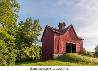 FLINT, MI/USA - JUNE 22, 2019: Calkins Barn at the Sloan Museum Auto Fair car show, held at Crossroads Village, near Flint, Michigan.
